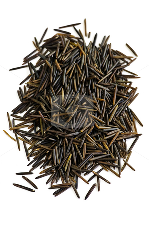 Wild black long grain rice stock photo, Pile of black wild long grain rice isolated on white background by Elena Elisseeva