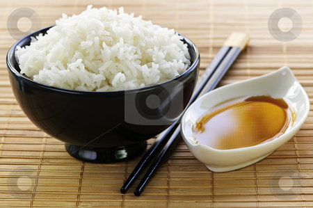 Rice meal stock photo, Rice bowl with soy sauce with chopsticks by Elena Elisseeva
