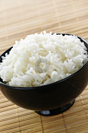 Rice bowl stock photo, White steamed rice in black round bowl by Elena Elisseeva