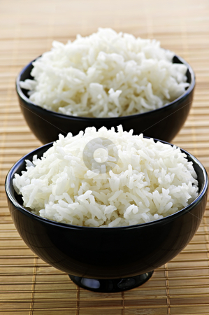 Rice bowls stock photo, White steamed rice in two black round bowls by Elena Elisseeva