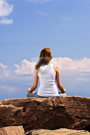 Young girl meditating stock photo, Portrait of young teenage girl doing yoga by Elena Elisseeva