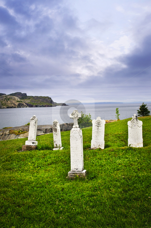 Tombstones near Atlantic coast in Newfoundland stock photo, Graveyard near rocky Atlantic shore in Newfoundland, Canada by Elena Elisseeva