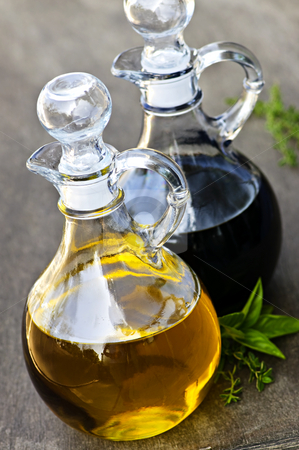Oil and vinegar stock photo, Oil and balsamic vinegar glass bottles with spouts by Elena Elisseeva