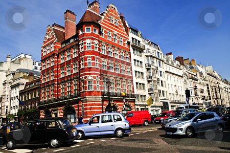 Busy street corner in London stock photo, London taxi on busy street corner in England by Elena Elisseeva