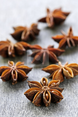 Star anise fruit and seeds stock photo, Dry star anise fruit and seeds on wooden background by Elena Elisseeva