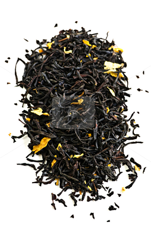 Black tea leaves stock photo, Pile of black tea leaves isolated on white background by Elena Elisseeva