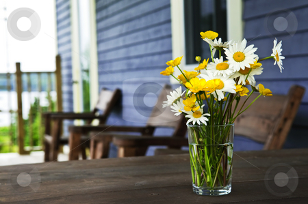 Wildflowers bouquet at cottage stock photo, Bouquet of wildflowers on a rustic table at country cottage by Elena Elisseeva
