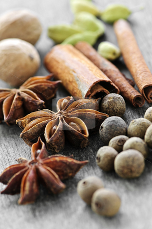 Assorted spices stock photo, Assorted whole spices close up on wooden background by Elena Elisseeva