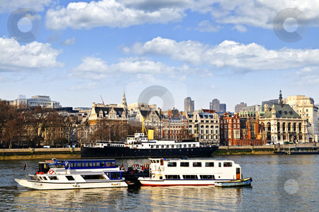 London skyline from Thames river stock photo, London skyline view from Thames river against blue sky by Elena Elisseeva