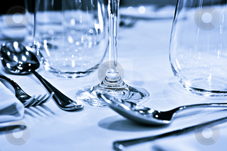 Tableware closeup stock photo, Close up view of table setting with cutlery and glasses by Elena Elisseeva
