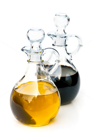 Oil and vinegar stock photo, Oil and balsamic vinegar glass bottles isolated on white by Elena Elisseeva