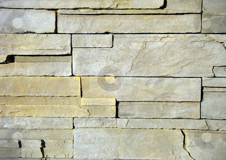 A slate brick wall on a building.  stock photo, Various shades of tan and gray slate brick in a pattern showing faces of the brick. by Lee Serenethos