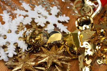 Christmas tree decorations stock photo, White and gold christmas tree decoration lying in a pile by Johann Helgason
