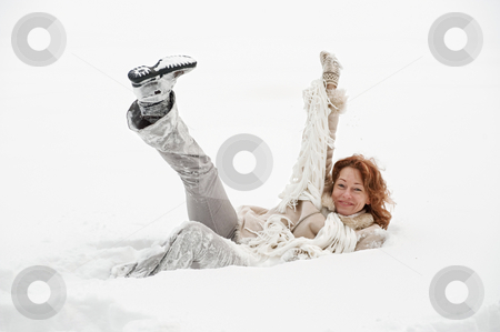 Winters joy stock photo, Attractive red-haired woman having fun in winters day. by Roberts Ratuts