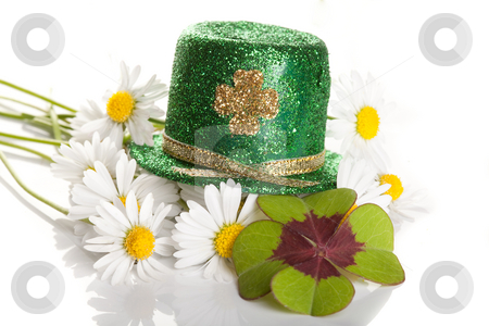 Clover and daisies stock photo, Shamrock and daisies on a Saint Patrick's hat by Anneke