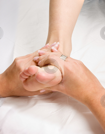 Foot massage stock photo, Female hands giving a healthy foot massage by Anneke