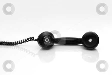 Antiquated phone stock photo, Antiquated phone handset with reflection by ikostudio