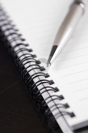 Notebook1 stock photo, Closeup of a notebook and a ballpoint pen by ??ystein Litleskare