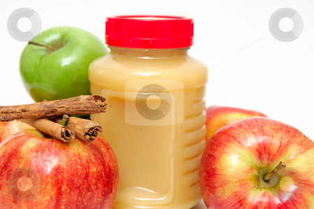 Jar Of Applesauce stock photo, Fresh Apples both green and red with a jar of store bought applesauce and cinnamon sticks by Lynn Bendickson