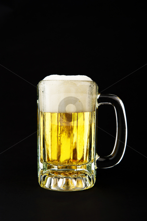 Cold Mug of Beer stock photo, Image of a mug of beer on black background by Greg Blomberg