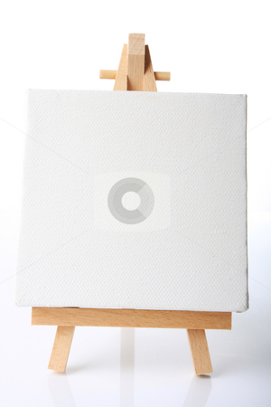 Empty canvas stock photo, Empty artistst canvas on an easel, shot on white, put your own image on it by Johann Helgason