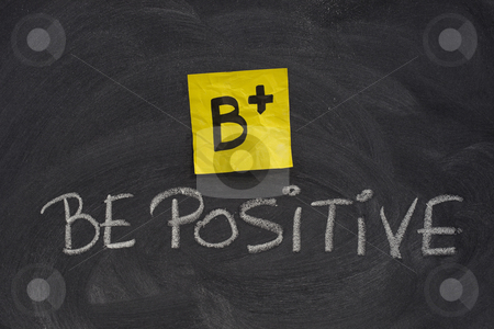 Be positive concept on blackboard stock photo, B+, be positive concept, yellow sticky note and white chalk handwriting on blackboard by Marek Uliasz