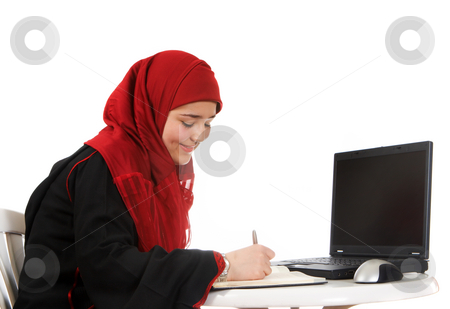 Veiled in the office stock photo, Young woman in an office, wearing a veil by Anneke