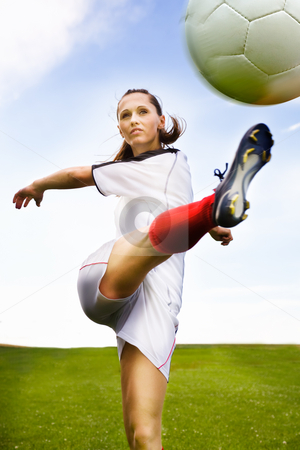 Football girl stock photo, A young female football player on the field by Val Thoermer