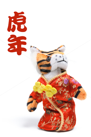 Toy Tiger in Chinese Costume stock photo, Toy Tiger in Chinese Costume on White Background by Lai Leng Yiap