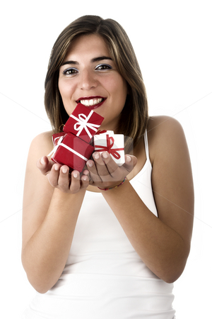 Christmas woman stock photo, Christmas season! Different poses of a beautiful woman with small gifts on the hands.  (Focus is especially on the gifts) by ikostudio