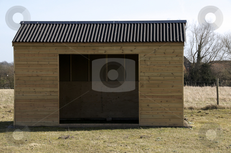 Shed stock photo, A wooden shed in field of grass by Mark Bond