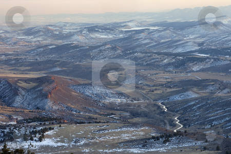 Hazy winter view of Colorado Rocky Mountains stock photo, Hazy winter view of foothills and Rocky Mountains in Colorado west of Fort Collins showing Big Thompson Project supply canal (transmountain water diversion) and Carter Lake by Marek Uliasz