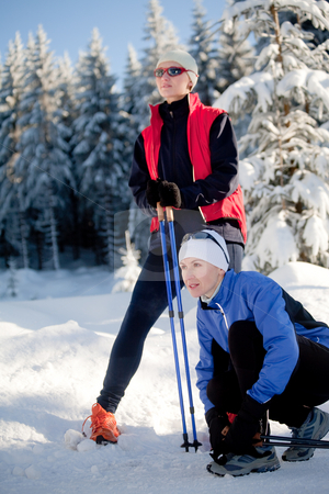 Winter sport stock photo, Female snow walking by Val Thoermer