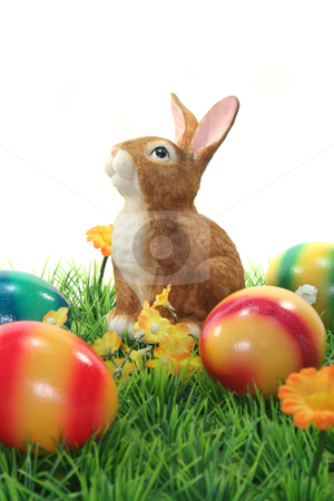 Easter bunny with eggs on a lawn stock photo, Easter bunny with Easter eggs on a flower meadow by Marén Wischnewski