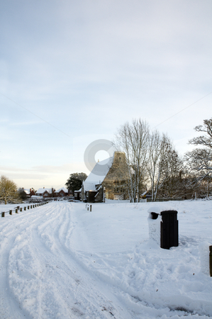 Winter church stock photo, A church covered in snow in a rural setting by Mark Bond
