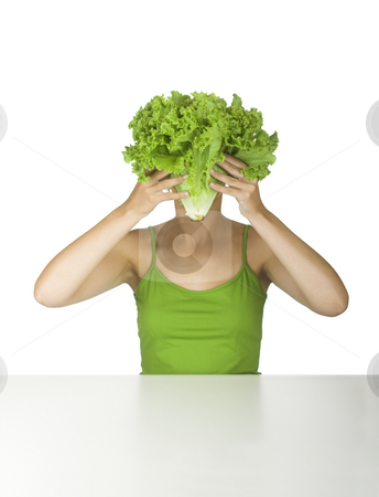 Lettuce head stock photo, Woman in green holding a lettuce in front of the face by ikostudio
