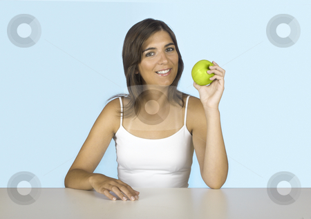 Apple diet stock photo, Beautiful young woman holding a green apple by ikostudio