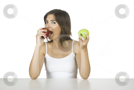 Apple diet stock photo, Beautiful young woman holding a green and a red apple by ikostudio