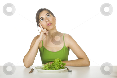 Lettuce diet stock photo, Beautiful woman in diet tired of eating lettuces all day by ikostudio