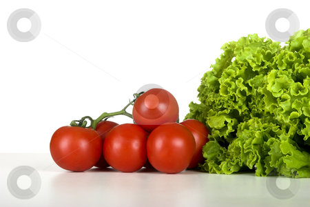 Healthy Vegetables stock photo, Healthy lettuce and tomatos over a white table by ikostudio