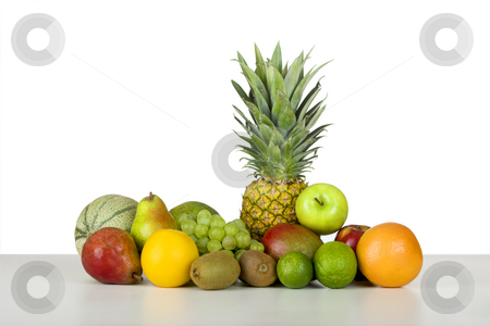 Vitamine bomb stock photo, Picture of fruits over a white table by ikostudio