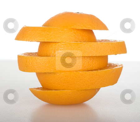 Orange slices stock photo, Picture of an orange in slices over a table by ikostudio