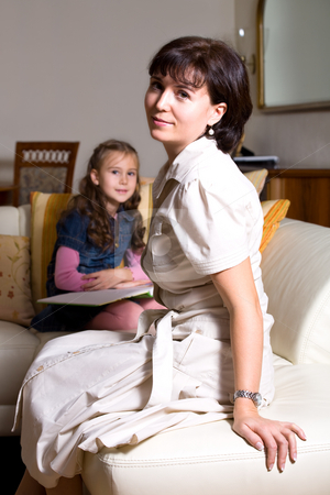 Reading family stock photo, Woman with daughter reading book by Val Thoermer