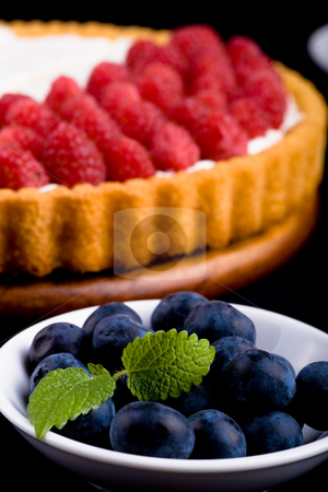 Pie stock photo, Different berries and fruits with a berry cake by Val Thoermer