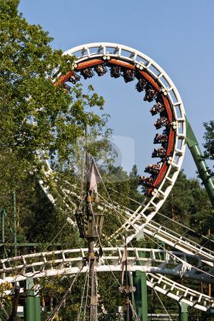 Rollercoaster in amusement park stock photo, Rollercoaster in amusement park with a blue sky background by Colette Planken-Kooij