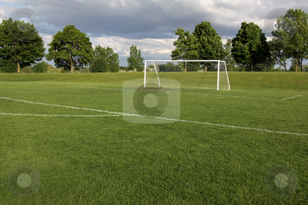 Vacant Soccer Pitch stock photo, A view of a net on a vacant soccer pitch. by Chris Hill