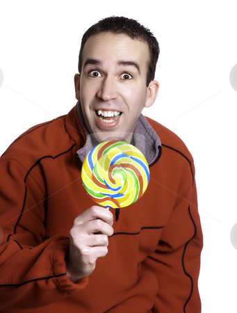 Man Holding Lollipop stock photo, A smiling man is holding a large lollipop, isolated against a white background. by Richard Nelson