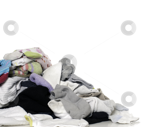 Unsorted Laundry stock photo, A pile of clean unsorted laundry, isolated against a white background by Richard Nelson