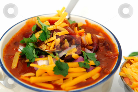 Chili Beans stock photo, Chili and beans in a ceramic bowl with onion, cilantro and cheddar cheese sprinkled on with with sides of each in stainless steel condiment cups. by Lynn Bendickson