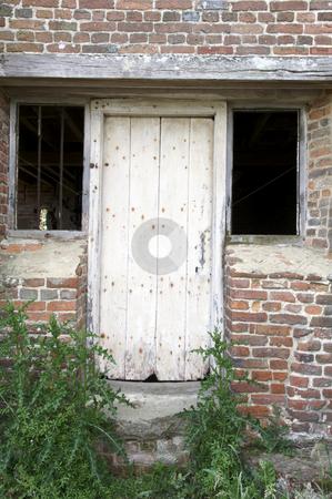 Old door stock photo, An old wooden door with brick wall by Mark Bond